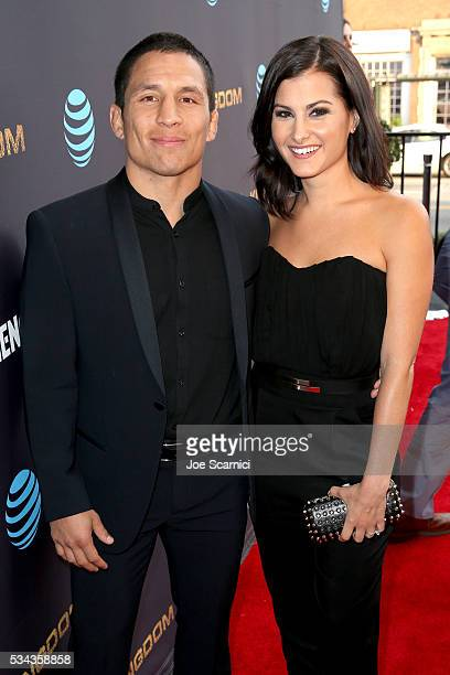 MMA fighter Joseph Benavidez and tv personality Megan Olivi attend as ATT Audience Network celebrates KINGDOM on May 25 2016 in Los Angeles California