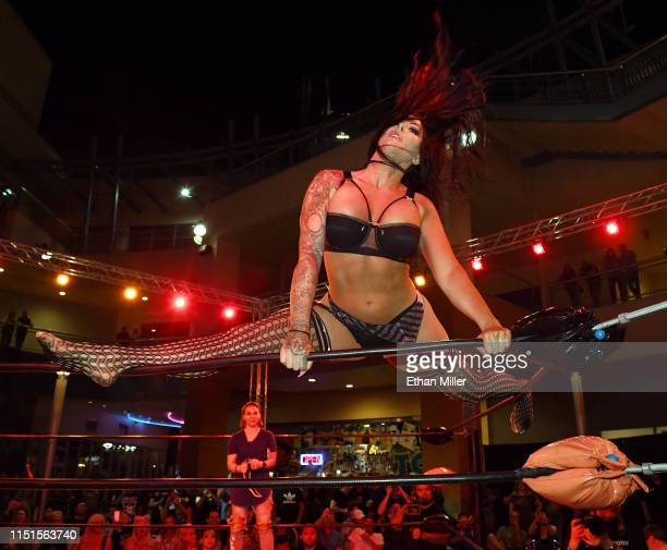 Fighter Katie The Bombshell Forbes climbs on top of the ropes as she is introduced before her match against Sheila Crash Cardinal during Lingerie...