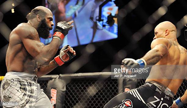 UFC fighter Kimbo Slice battles UFC fighter Houston Alexander during their Heavyweight fight at The Ultimate Fighter Season 10 Finale on December 5...