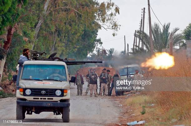 TOPSHOT A fighter loyal to the Libyan internationallyrecognised Government of National Accord fires a heavy machine gun during clashes against forces...