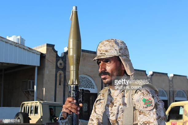 A fighter loyal to Yemen's President Abedrabbo Mansour Hadi holds a Rocket Propelled Grenade as he guards a position in Shabwa east of the Red Sea...
