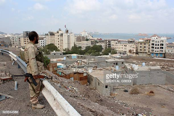 A fighter loyal to Yemen's President Abedrabbo Mansour Hadi looks on after they managed to secure completely and take control of the port of the...