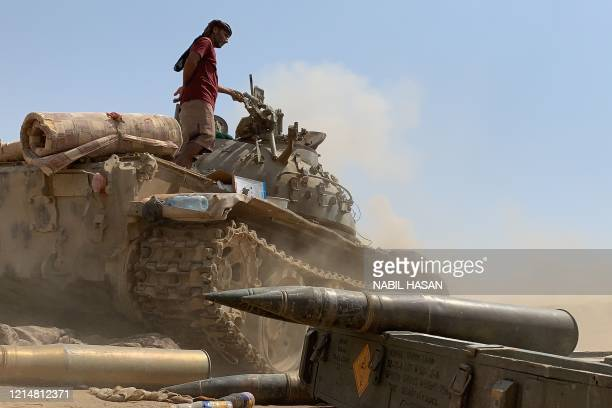 Fighter loyal to Yemen's separatist Southern Transitional Council stands atop a tank amid clashes with Saudi-backed government forces for control of...