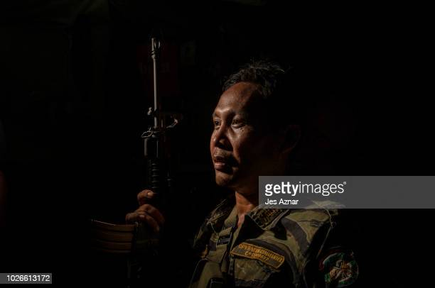 Fighter Madhie Eskak inside his house in Mamasapano, Maguindanao on August 23, 2018. Mr Eskak was drawn by the allure of guns when he was a teenager...