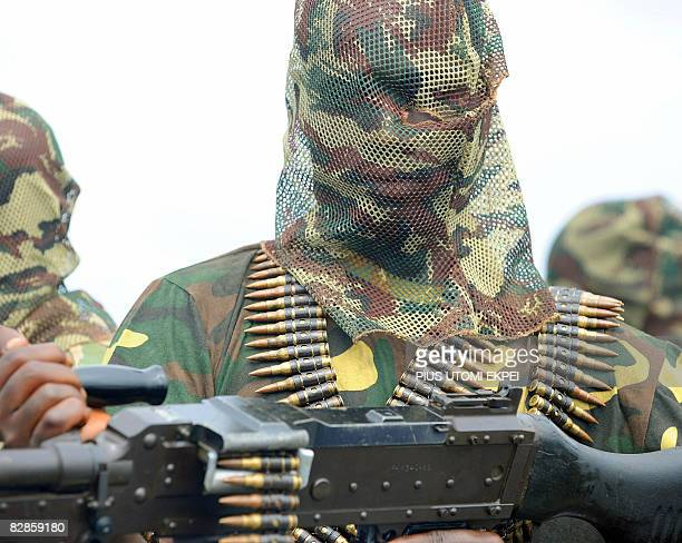 A fighter of the Movement for the Emancipation of the Niger Delta holds his heavy machinegun at the militia's creek camp in the Niger Delta on...