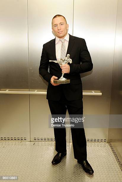 Fighter of the Year George St Pierre poses with his award at the Fighters Only World Mixed Martial Arts Awards at the Hard Rock Hotel and Casino on...