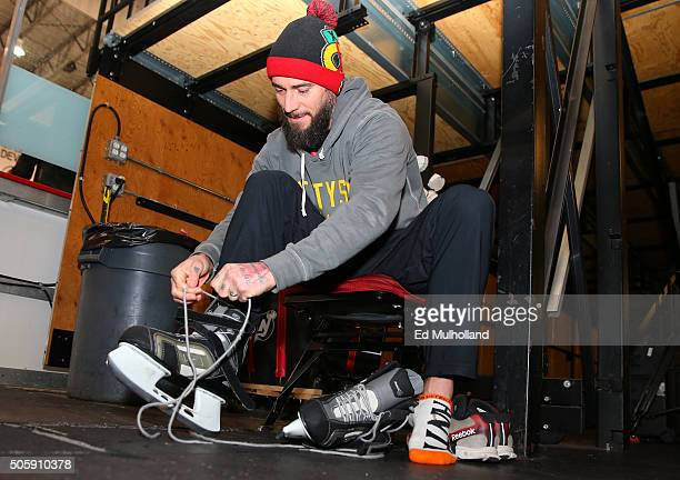 UFC fighter Phil CM Punk Brooks puts on skates at the New Jersey Devils national hockey league team practice at the Amerihealth Pavilion on January...