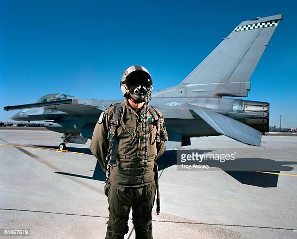 fighter pilot in front of jet