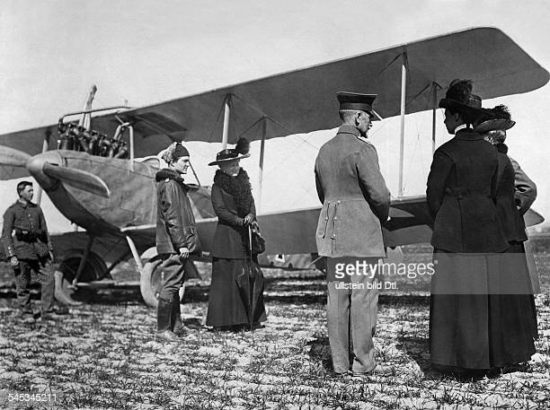 Fighter pilot von Richthofen explains Empress Augusta Victoria his flying machine Albatros