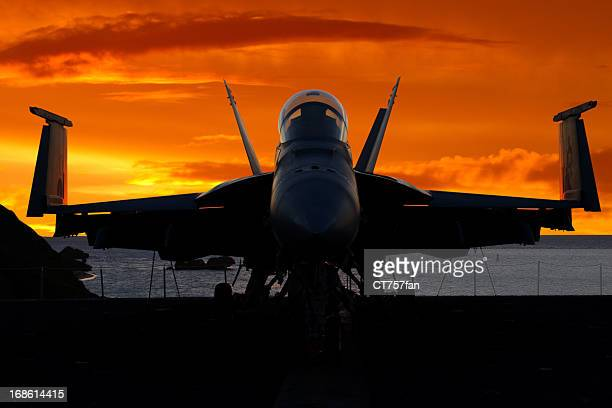 fighter plane at sunrise - military ship stock pictures, royalty-free photos & images