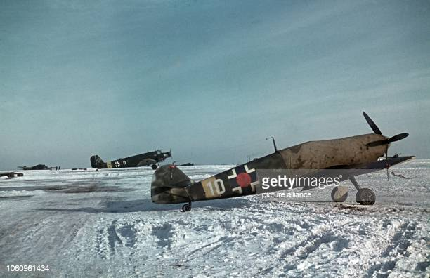 Fighter plane Messerschmitt Me109 Type F on the airfield in Dnjeproetrowsk Ukraina In the background a JU52 Picture taken in 1943