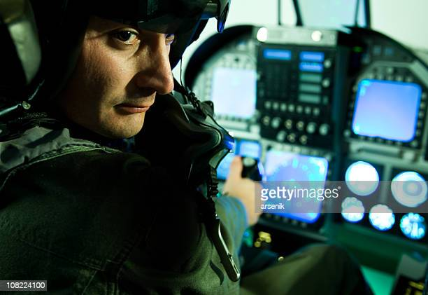 fighter plane pilot holding throttle and sitting cockpit - cockpit stock pictures, royalty-free photos & images