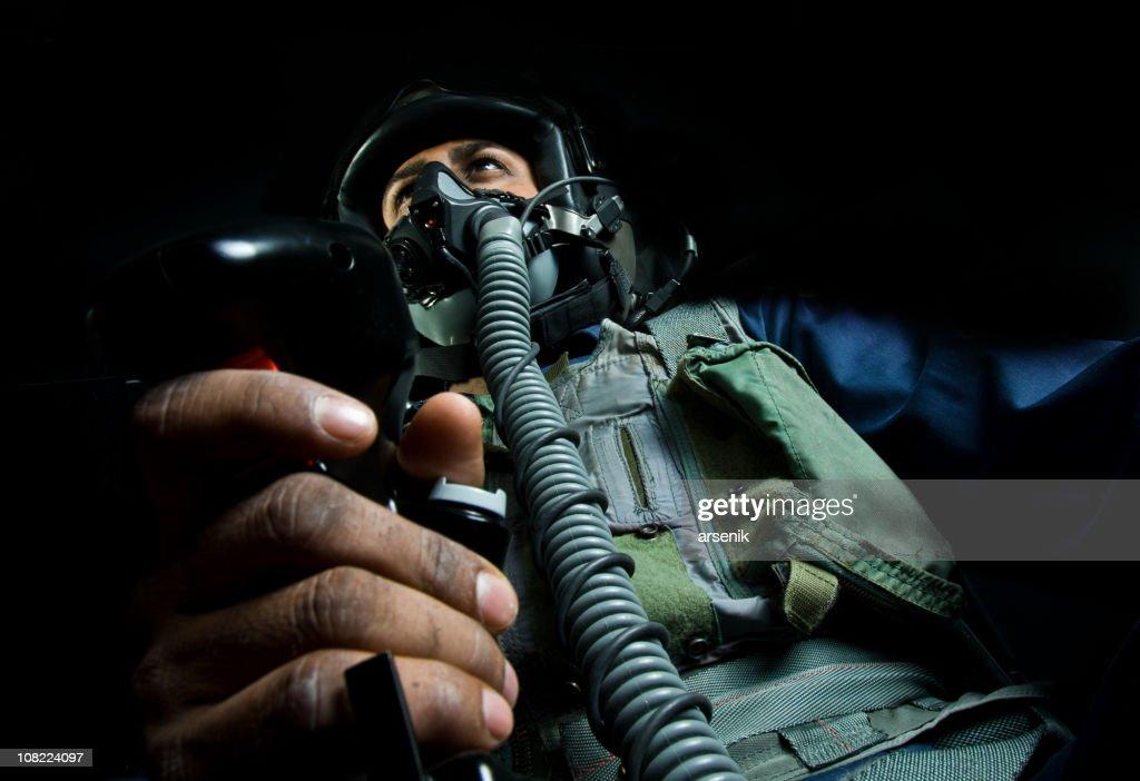 Fighter Plane Pilot Holding Throttle Wearing Helmet : Stock Photo
