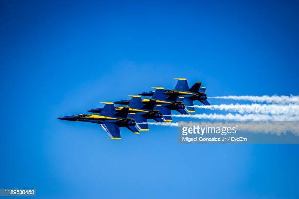 fighter planes flying against clear blue sky - 航空ショー ストックフォトと画像
