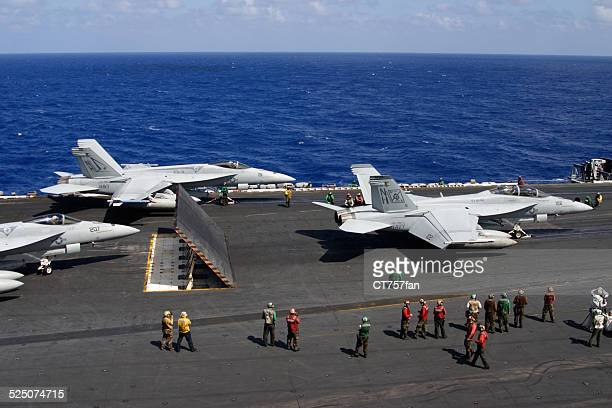 Fighter Planes preparing to launch from USS Nimitz Aircraft Carrier
