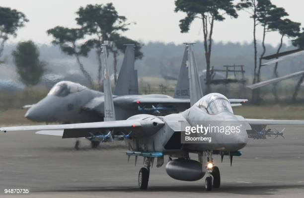 F15 fighter planes taxi at the Hyakuri Base where Ibaraki Airport is under construction in Omitama City Ibaraki Prefecture Japan on Sunday Oct 19...