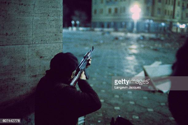 A fighter points his rifle toward the streets of Timisoara Romania during insurrection against Communist leader Nicolae Ceausescu Ceaucescu rose...