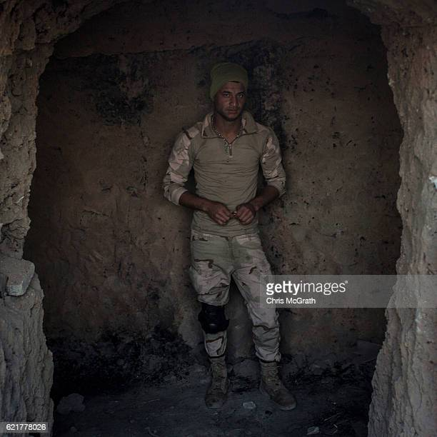 Fighter poses for a portrait inside an ISIL tunnel on a hillside above an NPU checkpoint on November 8, 2016 in Qaraqosh, Iraq. The NPU is a military...