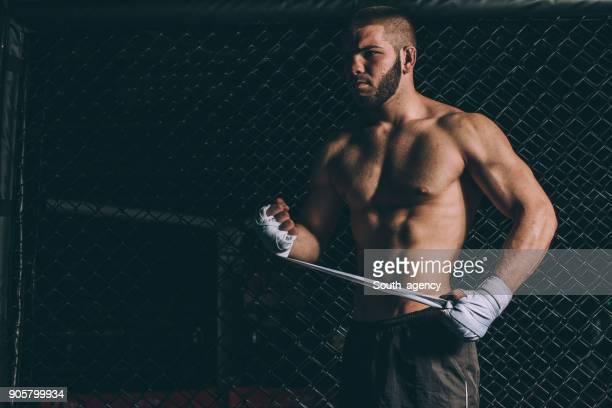 Fighter preparing bandages for training