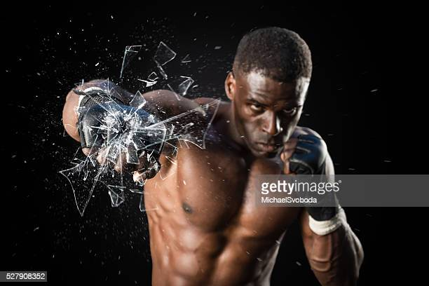 fighter punching close up glass shattering - punching stock pictures, royalty-free photos & images