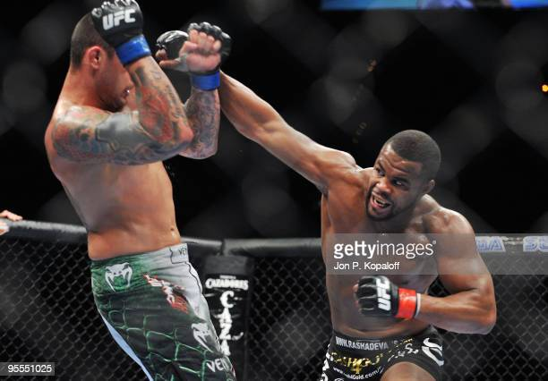 Fighter Rashad Evans battles UFC fighter Thiago Silva during their non title Light Heavyweight fight at UFC 108: Evans vs. Silva at the MGM Grand...