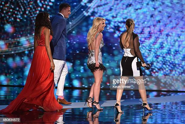 UFC fighter Ronda Rousey accepts the Best Female Athlete award from recording artist Britney Spears and NFL player J J Watt onstage during The 2015...