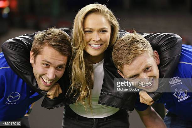 UFC fighter Ronda Rousey poses with Jamie Macmillan and Jack Ziebell of the Kangaroos AFL team on September 16 at Etihad Stadium 2015 in Melbourne...