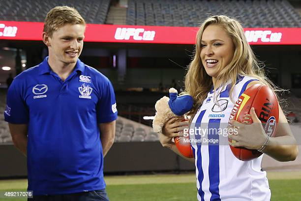 UFC fighter Ronda Rousey wears a Kangaroos AFL guernsey given to her by Jack Ziebell of the Kangaroos players on September 16 at Etihad Stadium 2015...