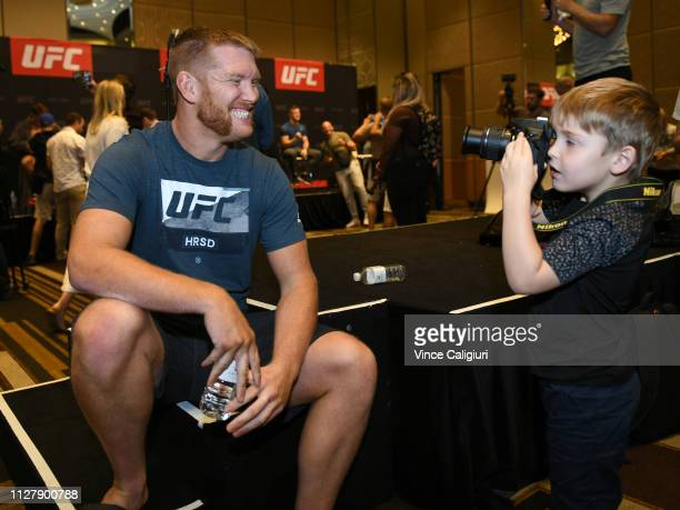 Fighter Sam Alvey poses for his son taking a picture during the UFC 234 Ultimate Media Day at Crown Palladium on February 07, 2019 in Melbourne,...