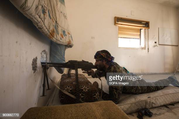 SDF fighter shooting Islamic State group jihadists position close to the Raqqa stadium The Syrian civil war has been carried on for more than 6 years...