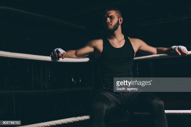 Fighter sitting in the boxing ring