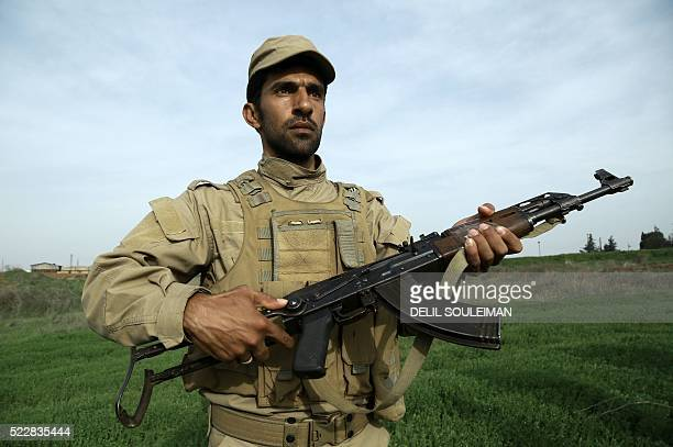 A fighter taking part in an obligatory nine month training to join the Autonomous Protection Forces poses for a photo at a training camp in the...