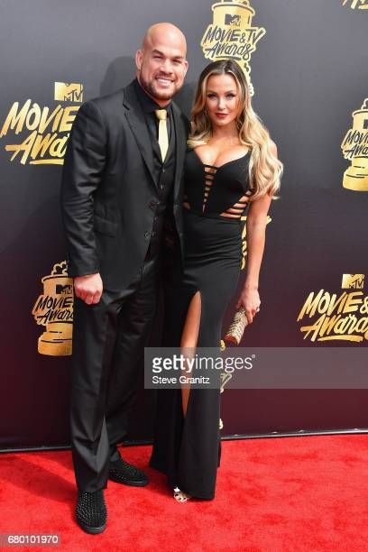 MMA fighter Tito Ortiz and Amber Nichole Miller attend the 2017 MTV Movie and TV Awards at The Shrine Auditorium on May 7 2017 in Los Angeles...