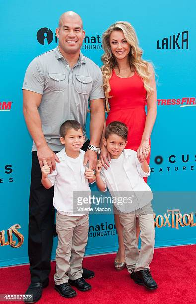 Fighter Tito Ortiz and model Amber Miller arrive at the premiere of Premiere Of Focus Features' The Boxtrolls at Universal CityWalk on September 21...