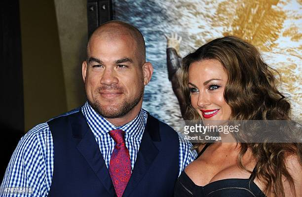 Fighter Tito Ortiz and model Amber Miller arrive for the Premiere Of Warner Bros Pictures And Legendary Pictures' '300 Rise Of An Empire' held at TCL...