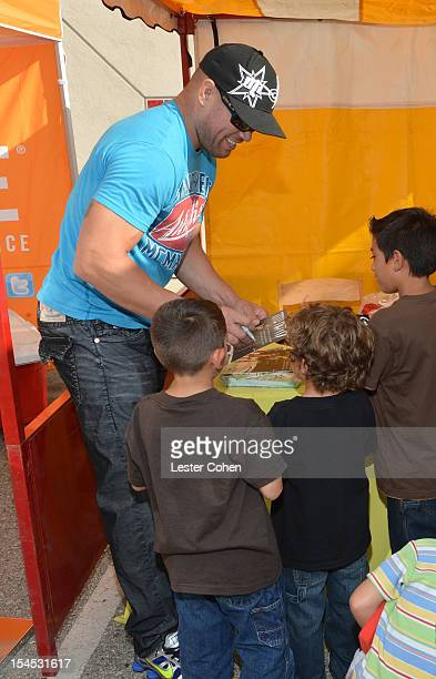 UFC fighter Tito Ortiz signs autographs for kids at the Bogart Pediatric Cancer Research Program's A Day Of Champions Children's Choice Award...