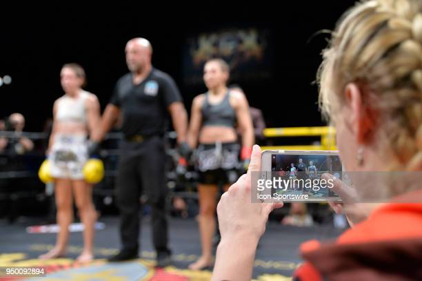 Fighter Valentina Shevchenko takes a photo of her sister Antonina Shevchenkoafter winning the bout Antonina Shevchenko takes on Claire Baxter in a...