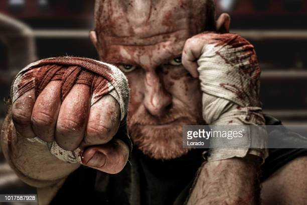 MMA fighter wearing bloody straps