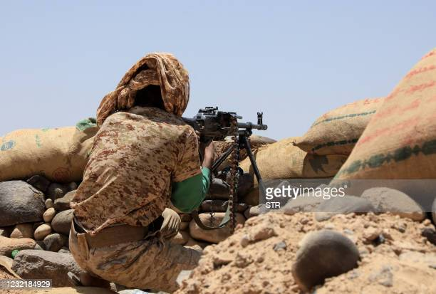 Fighter with forces loyal to Yemen's Saudi-backed government holds a position against Huthi rebels in Yemen's northeastern province of Marib, on...