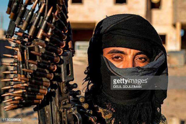 A fighter with the Syrian Democratic Forces is pictured in the town of Baghouz on the frontline of fighting to expel the Islamic State group from the...