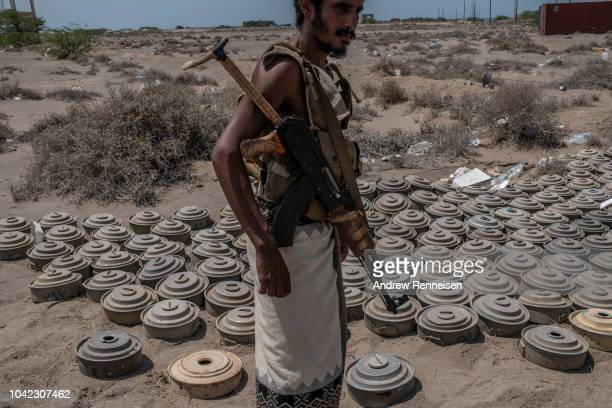 Fighter with the Tariq Salah Forces, a militia aligned with Yemen's Saudi-led coalition-backed government, shows Houthi rebel landmines the militia...