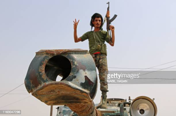 Fighter with the UAE-trained Security Belt Forces loyal to the pro-independence Southern Transitional Council , stands atop a military vehicle near...