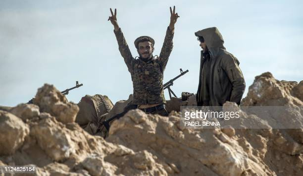 A fighter with the USbacked Syrian Democratic Forces flashes the 'V' for victory sign during an operation to expel Islamic State group jihadists from...