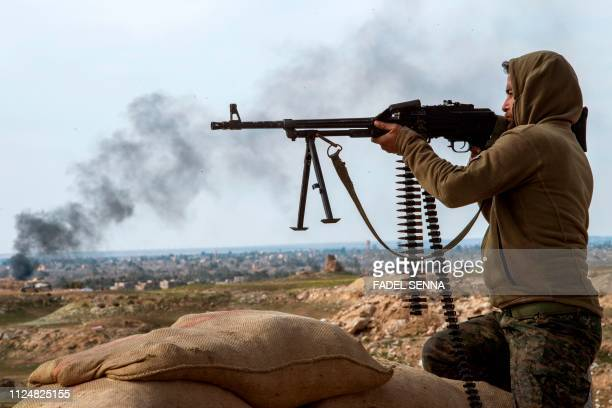 A fighter with the USbacked Syrian Democratic Forces keeps a position during an operation to expel Islamic State group jihadists from the Baghouz...