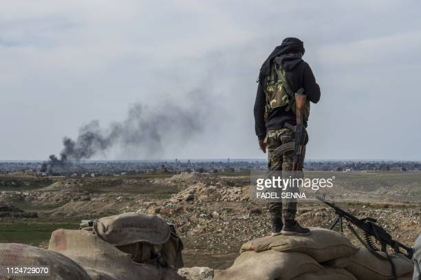 TOPSHOT A fighter with the USbacked Syrian Democratic Forces keeps position during an operation to expel Islamic State group jihadists from the...