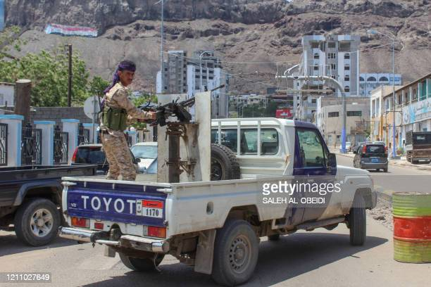 Fighter with Yemen's separatist Southern Transitional Council mans a gun in the back of a vehicle deploying in the southern city of Aden, on April 26...