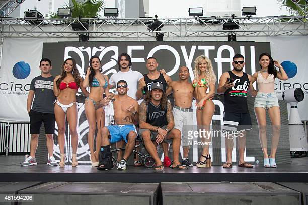 Fighters and Octagon Girls pose for a picture during the Foxtail pool party at SLS Las Vegas during UFC International Fight Week on July 9 2015 in...