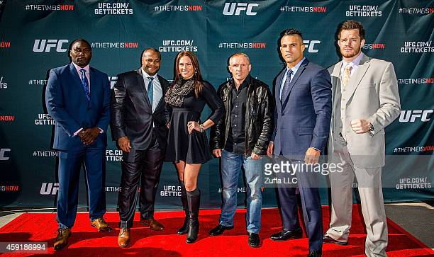 UFC fighters Anthony Johnson Daniel Cormier Cat Zingano Dennis Siver Vitor Belfort and CB Dollaway arrive at the UFC Time Is Now press conference at...