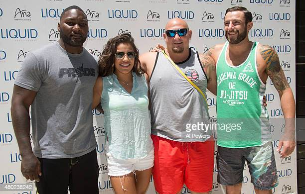 UFC fighters Anthony Johnson Juliana Pena Shawn Jordan and Michael Chiesa pose for photos during a UFC pool party as part of the International Fight...