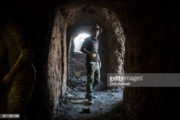 Fighters are seen inside an ISIL tunnel on a hillside above an NPU checkpoint on November 8, 2016 in Qaraqosh, Iraq. The NPU is a military...